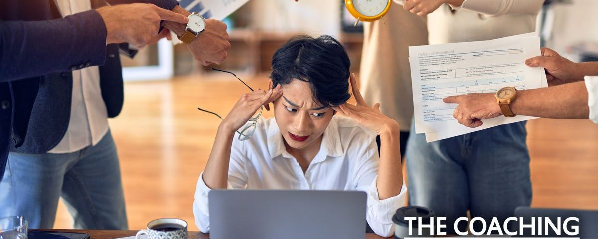 Stressed Manager at desk not setting boundaries